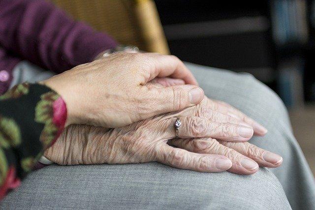 Dementia patient holding hands